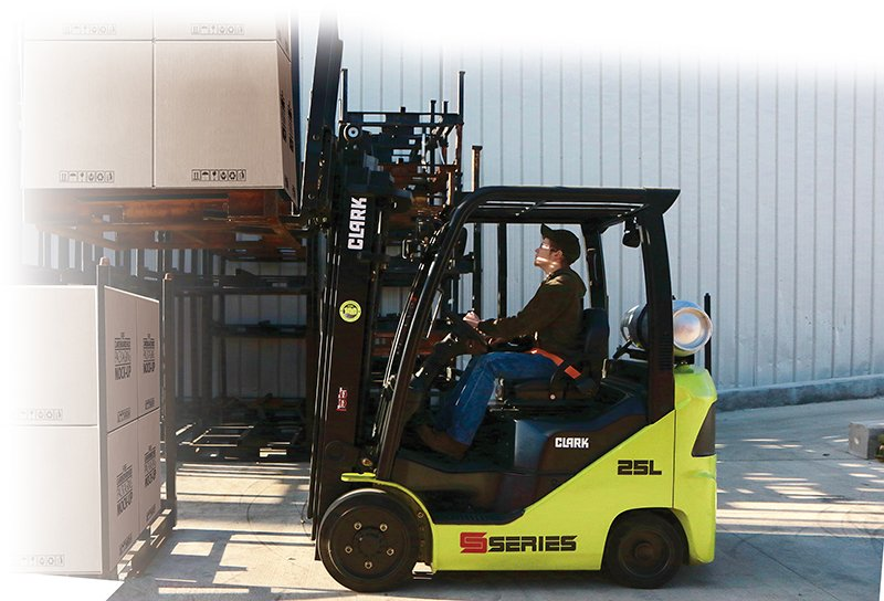 Person operating Clark S-Series Cushion forklift