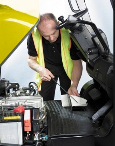 Technician performing maintenance on Clark forklift