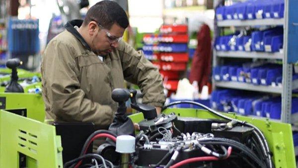Technician repairing Clark forklift